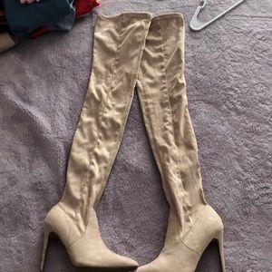 Thigh high beige boots